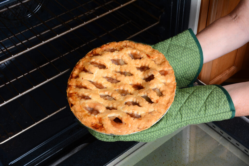 Taking Apple Pie From Oven