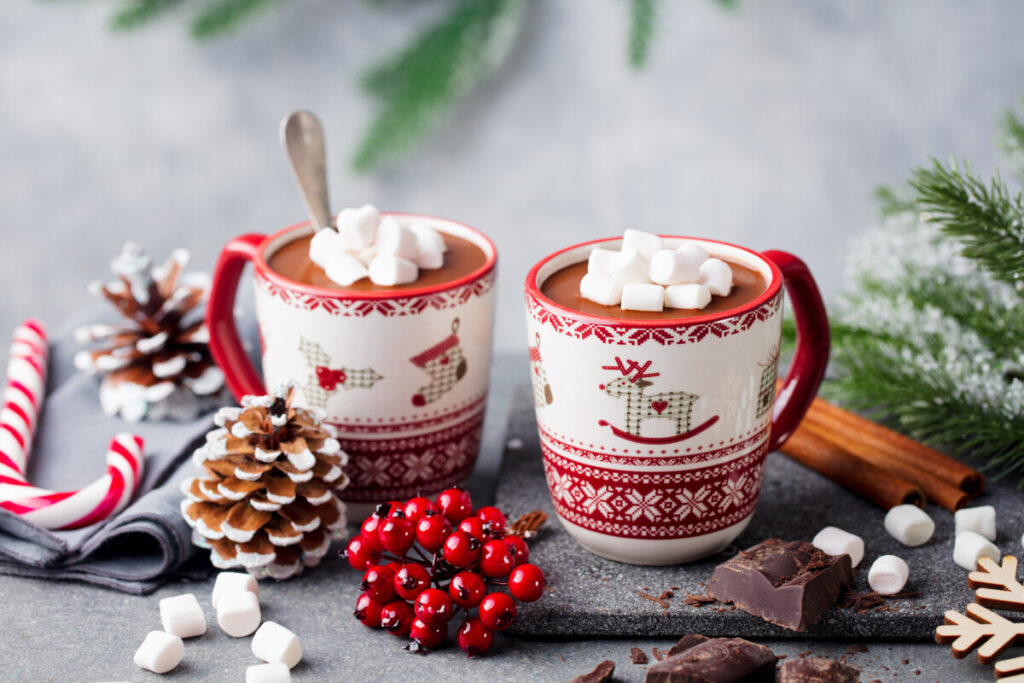 Hot chocolate drink with marshmallows in Christmas mugs. Christmas, New Year's decoration.